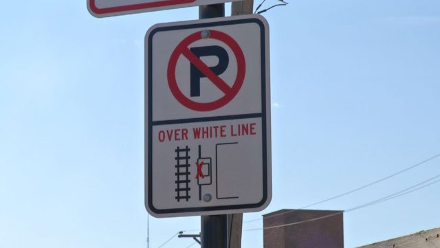 It's a $72.50 ticket if your entire vehicle, including the side mirrors, aren't between the curb and the white line. It's another $270 if your car gets towed. (KCTV5)