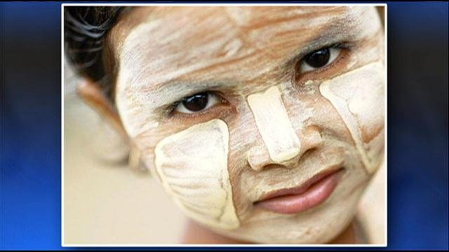 "The product, which is called Thanakha, and is also spelled ""thanaka"" or ""tanaka,"" is a yellowish paste made from tree bark that is worn on the face and arms to treat acne or as a sunscreen."