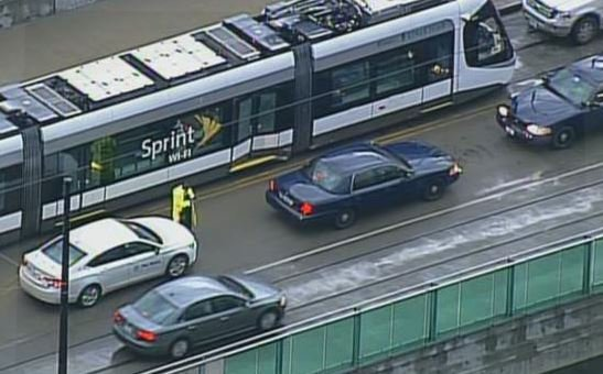 Officials say the Streetcar was out of service after it collided with a car driving eastbound at Truman and Main Thursday evening. (Source: Chopper5)