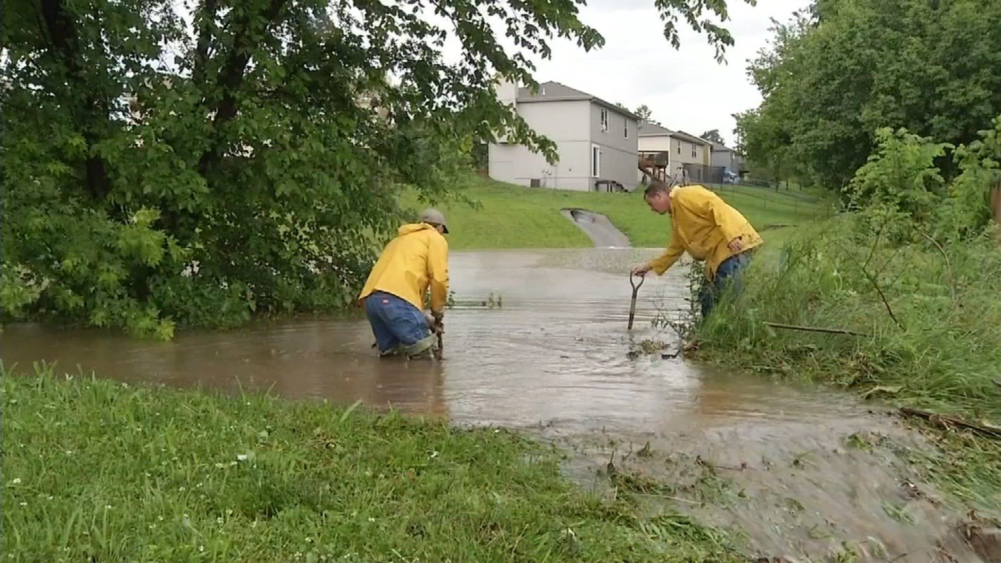 A detention basin near North Blue Mills Road and East 16th North Street is meant to drain the rain during heavy downpours, but the city found out it's clogged. The water had to go somewhere and it turned the couple's yard into a pond. (KCTV)