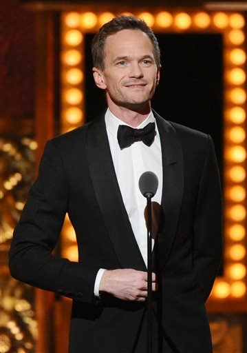 (Photo by Charles Sykes/Invision/AP, File). FILE - In this June 7, 2015 file photo, Neil Patrick Harris presents an award at the 69th annual Tony Awards in New York. Harris will serve as a presenter for this year's Tony Awards, help Sunday, June 12, at...