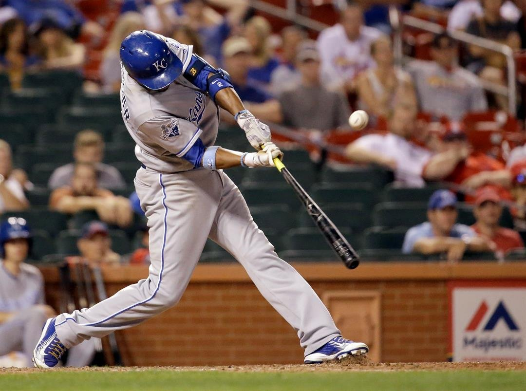Kansas City Royals' Alcides Escobar hits an RBI double during the 12th inning of a baseball game against the St. Louis Cardinals on Wednesday, June 29, 2016, in St. Louis. (AP Photo/Jeff Roberson)