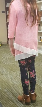 Bella Jones, 11, was wearing flowered stretch leggings and a pink sweater. The school said the outfit was too revealing. (KCTV5)