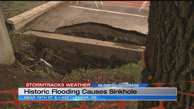 Sinkhole opens up in parking lot of a Lenexa apartment complex