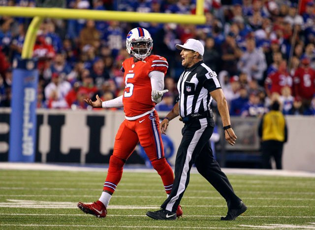 Buffalo Bills quarterback Tyrod Taylor (5) is walked off the field by referee Ed Hochuli during the second half an NFL football game against the New York Jets on Thursday, Sept. 15, 2016, in Orchard Park, N.Y. (AP Photo/Bill Wippert)
