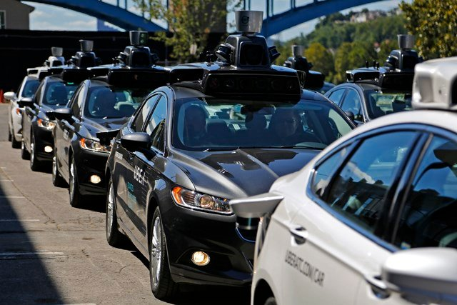In Pittsburgh, starting Wednesday morning, Sept. 14, 2016 dozens of self-driving Ford Fusions will pick up riders who opted into a test program with Uber. (AP Photo/Gene J. Puskar)
