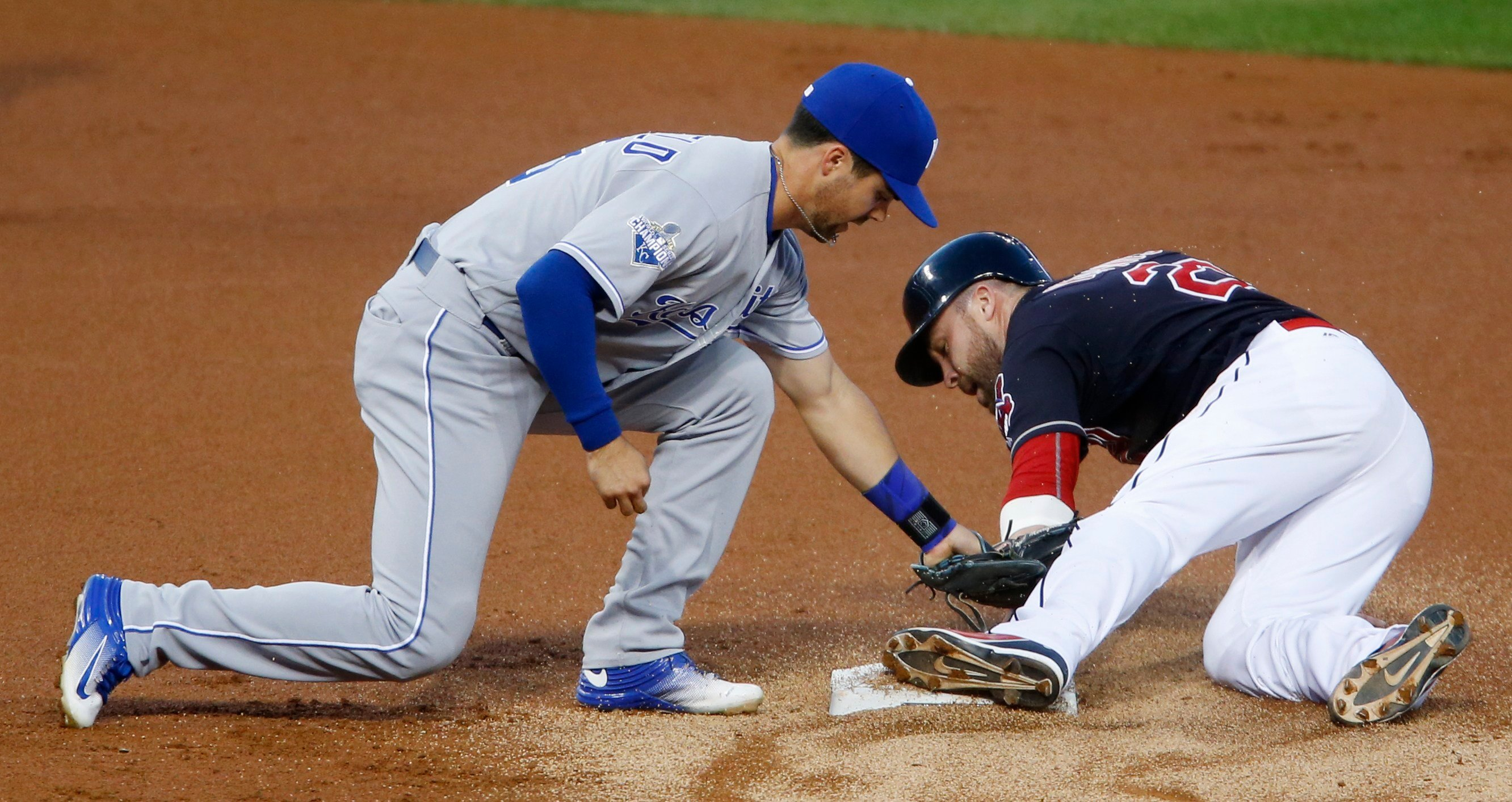 Cleveland Indians' Jason Kipnis, right, steals second base as Kansas City Royals' Whit Merrifield applies a late tag during the first inning of a baseball game Tuesday, Sept. 20, 2016, in Cleveland. (AP Photo/Ron Schwane)