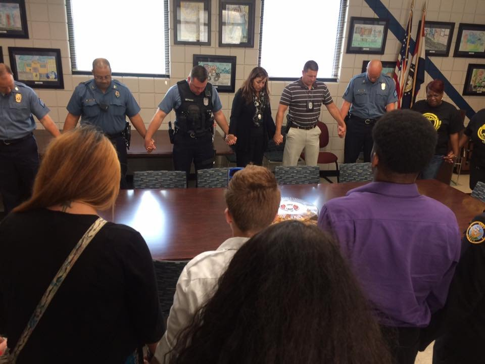 Mothers in Charge and Job Corps Youth traveled throughout Kansas City on Wednesday, thanking police officers and praying for their protection. (Natalie Davis/KCTV5)