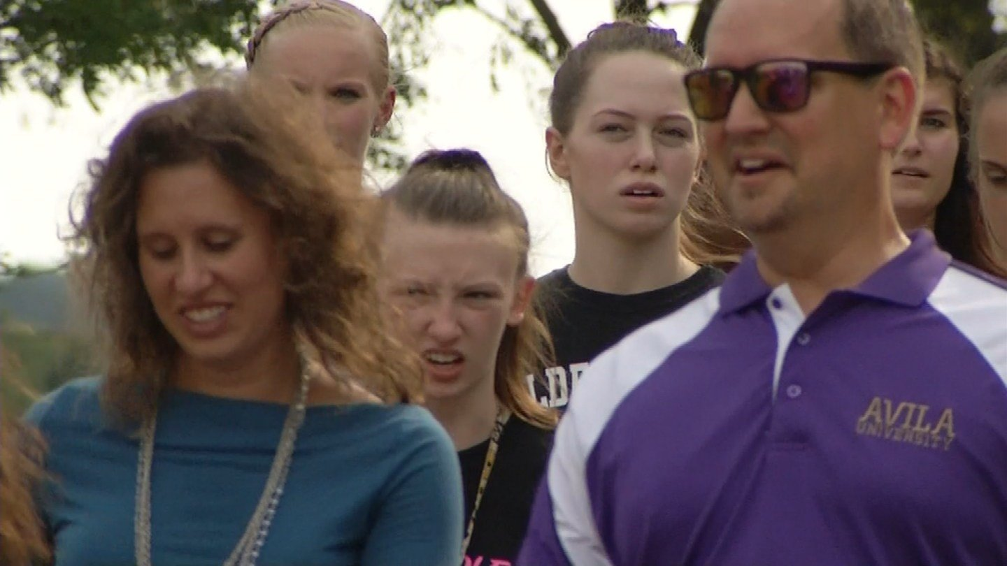 About 70 students and staff at the small Catholic college walked in silence from one school landmark to another. (KCTV5)