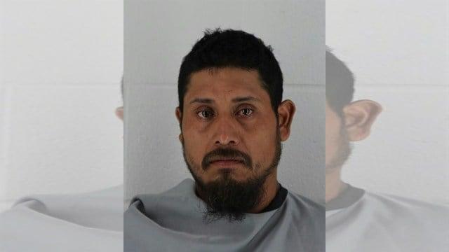 Adrian Espinosa-Flores' mugshot.