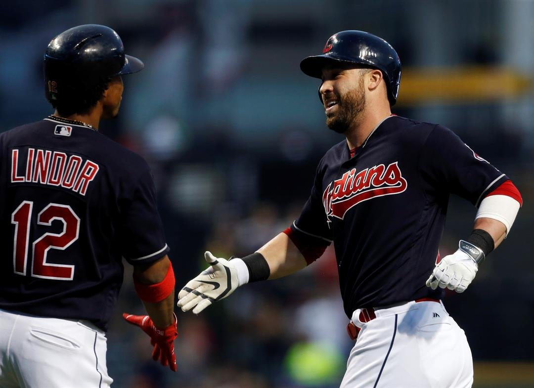Carlos Santana's three-run homer pushed the Cleveland Indians to a 5-2 win over the Kansas City Royals on Thursday night and nearer to their first AL Central championship since 2007. (AP PHOTOS)