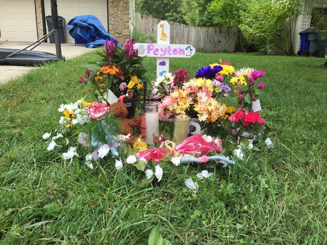 A picture of the memorial created for the young girl who was killed by a car on Saturday. (Adam Wilson/KCTV5)