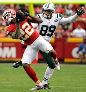 Kansas City Chiefs defensive back Marcus Peters (22) intercepts a ball intended for New York Jets wide receiver Jalin Marshall (89) for a turnover during the first half of an NFL football game in Kansas City, Mo., Sunday, Sept. 25, 2016. (AP)