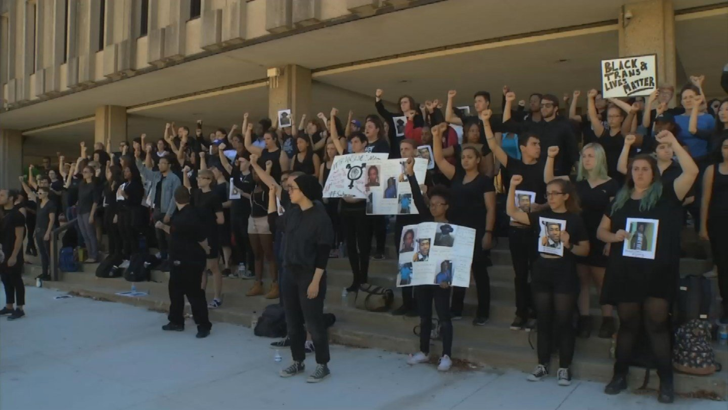 A group of University of Kansas students stood silent to make a point about black lives and trans lives. (KCTV5)