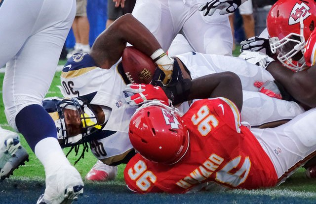 Los Angeles Rams running back Todd Gurley, left, sneaks in for a touchdown as Kansas City Chiefs defensive end Jaye Howard puts on a late tackle during the first half of a preseason NFL football game, Saturday, Aug. 20, 2016, in Los Angeles. (AP)