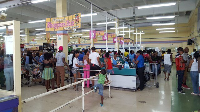 "The scene at a grocery store in Jamaica on Sunday. ""All lines went to the back of the supermarket,"" Johnson said. (Ja'dan Johnson/KCTV5)"