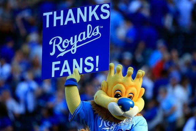 Kansas City Royals mascot Sluggerrr thanks fans following a baseball game against the Cleveland Indians at Kauffman Stadium in Kansas City, Mo., Sunday, Oct. 2, 2016. The Indians defeated the Royals 3-2. (AP Photo/Orlin Wagner)