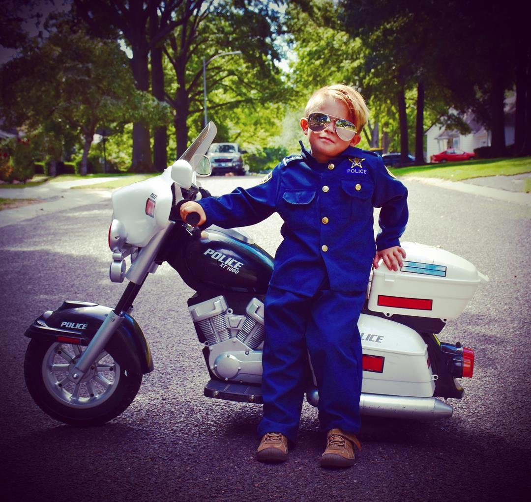 Oliver, on his motorcycle complete with aviators, wants to be a police officer. (Brandi Davis)