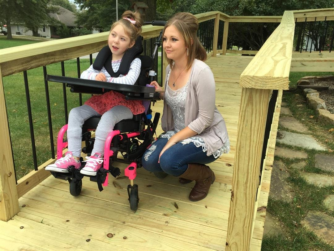 The Dawson family closed  on their new house in Liberty on Monday, but Whitney Dawson wondered how her daughter, Lexi Dawson, could get inside. That changed due to some very generous people. (Grady Reid/KCTV5)
