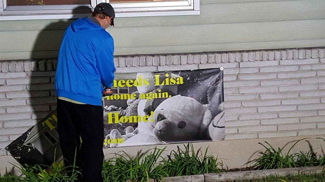 The old banner about Lisa's disappearance was taken down Saturday evening after it didn't meet city code. A new banner was put up. (Laura Lombardi)