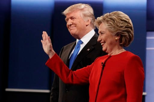 In the first poll taken after the tape was released, Hillary Clinton leads Donald Trump by 11 points. (AP PHOTO)