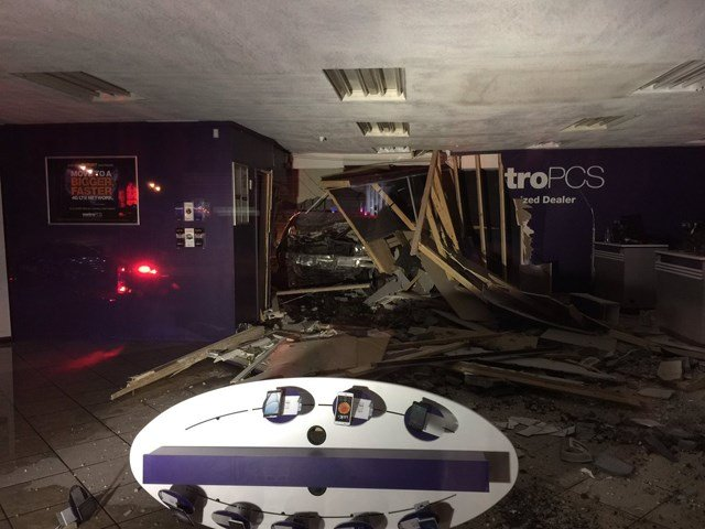 There was also damage to the inside of the store including a knocked over kiosk and shards of cement pushed into the front of the store. (KCTV5)