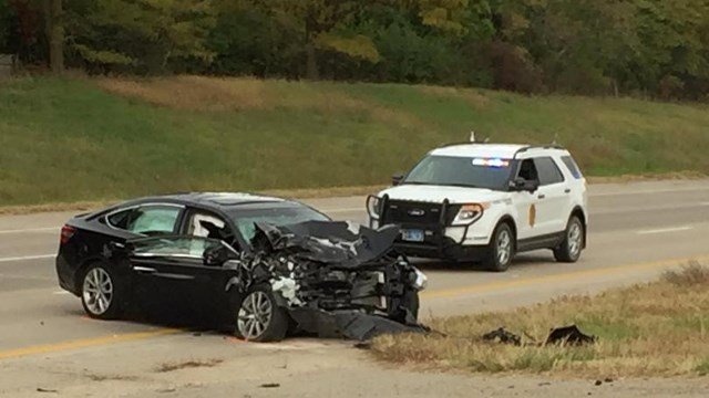 The car that hit a KHP trooper parked on the side of the interstate. (Nick Viviani/WIBW)