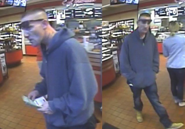 Police are attempting to identify this man who cashed stolen lottery tickets. (Lee's Summit Police Department)