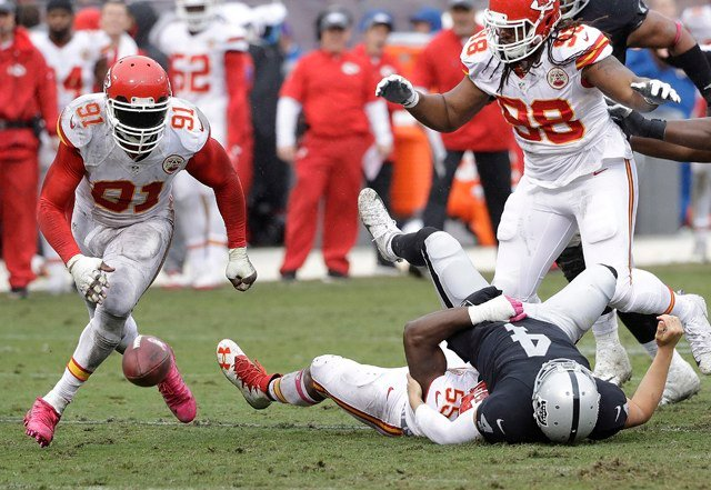 Up 26-10, the Chiefs defense delivered the final nail in the coffin. With the Raiders driving deep into Kansas City territory, Dee Ford stripped Carr of the ball, forcing a fumble. (AP)