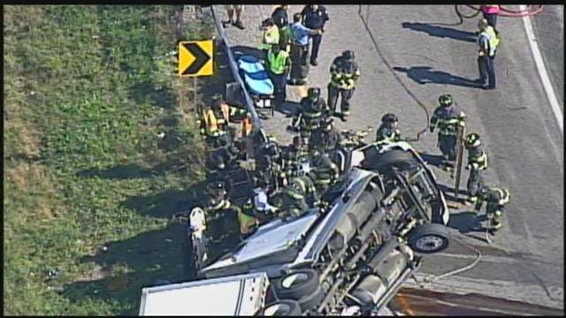 Firefighters extricated a driver after a rollover crash involving a semi.  The wreck happened about noon Monday at Interstate 435 and Interstate 70. (Chopper5)