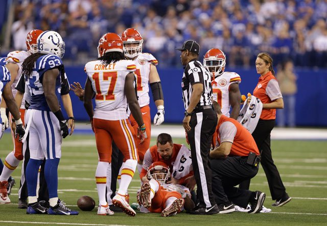 Kansas City Chiefs quarterback Alex Smith lays on the field after getting hit during the second half of an NFL football game against the Indianapolis Colts, Sunday, Oct. 30, 2016, in Indianapolis. (AP Photo/Michael Conroy)