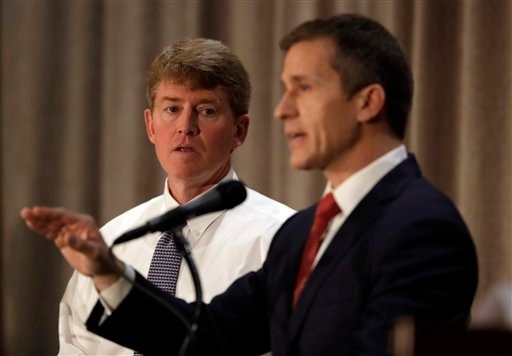 Democratic gubernatorial candidate Chris Koster, left, listens to Republican challenger Eric Greitens during the first general election debate in the race for Missouri governor at the Missouri Press Association convention Friday, Sept. 30, 2016. (AP)