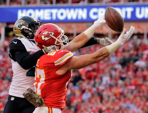 Kansas City Chiefs tight end Travis Kelce was ejected after complaining to officials for not calling a pass interference penalty, then whipping his towel at the official as if it was a flag. (AP)