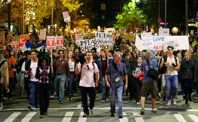 Hundreds of protesters march in downtown Seattle as they protest the election of President-elect Donald Trump, Wednesday, Nov. 9, 2016. A day after Trump's election as president, the divisions he exposed only showed signs of widening as many thousands of
