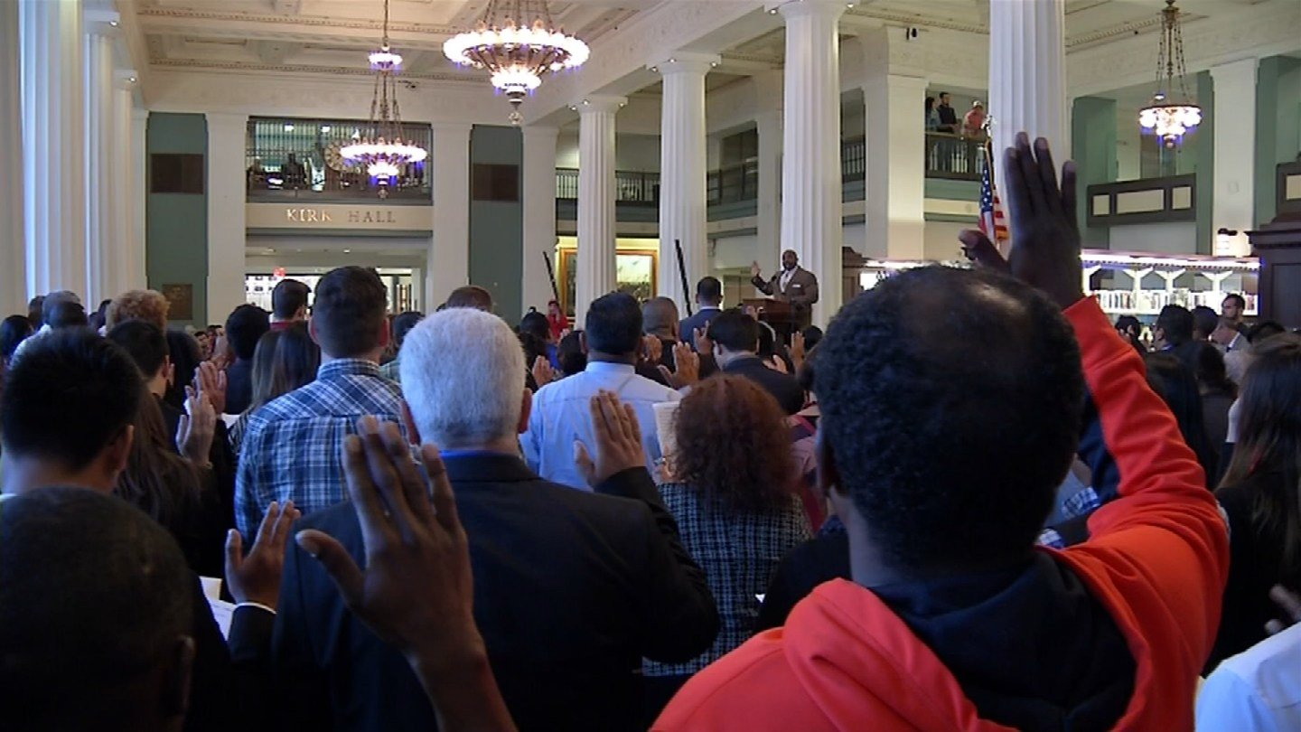 The 110 legal naturalized citizens are from 45 nations. (KCTV)
