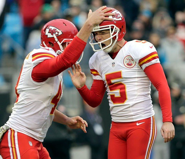 Kansas City Chiefs' Cairo Santos (5) celebrates with teammate James Winchester (41) after kicking the game-winning field goal against the Carolina Panthers in the final second of the second half in Charlotte, N.C. (AP Photo/Chuck Burton)