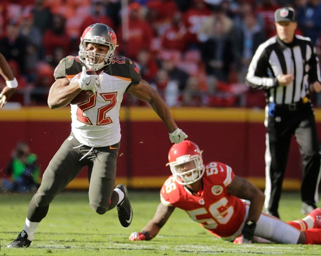 Tampa Bay Buccaneers running back Doug Martin (22) runs past a tackle attempt by Kansas City Chiefs linebacker Derrick Johnson (56) during the second half of an NFL football game in Kansas City, Mo., Sunday, Nov. 20, 2016. (AP)