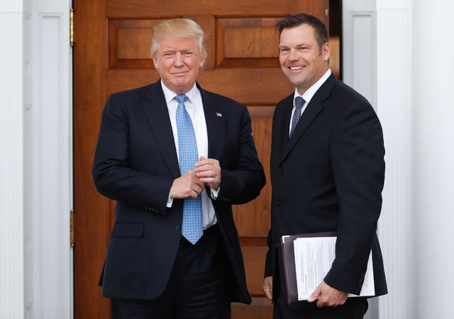 President-elect Donald Trump pauses pose for photographs as he greets Kansas Secretary of State, Kris Kobach, at the Trump National Golf Club Bedminster clubhouse, Sunday, Nov. 20, 2016, in Bedminster, N.J.. (AP Photo/Carolyn Kaster)