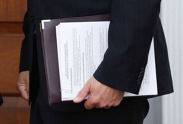 "In this Nov. 20, 2016, photo, Kansas Secretary of State Kris Kobach's ""Department of Homeland Security Kobach Strategic Plan for First 365 Days"" document was visible in a photograph from The Associated Press. (AP Photo/Carolyn Kaster)"