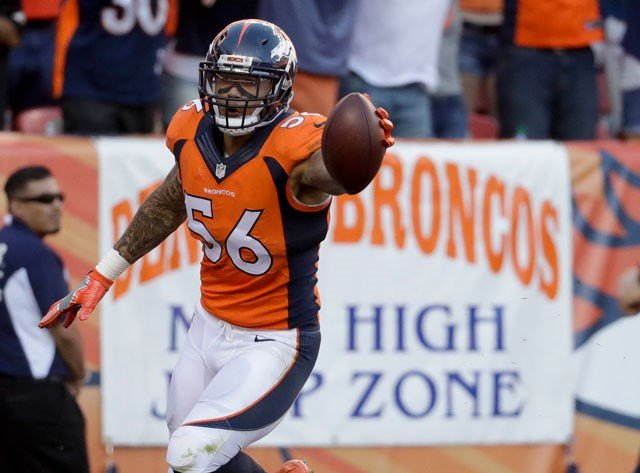 FILE - In this Sept. 18, 2016, file photo, Denver Broncos linebacker Shane Ray celebrates after scoring during the second half in an NFL football game against the Indianapolis Colts in Denver. (AP Photo/Jack Dempsey, File)