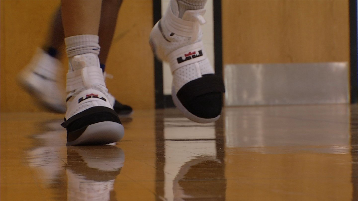 The shoes were an effort to motivate the team, coming off of their first state championship. (KCTV)