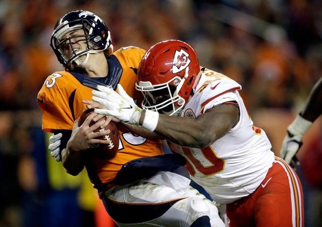 Kansas City Chiefs outside linebacker Justin Houston (50) sacks Denver Broncos quarterback Trevor Siemian (13) in the end zone for a safety during the first half of an NFL football game, Sunday, Nov. 27, 2016, in Denver. (AP Photo/Joe Mahoney)