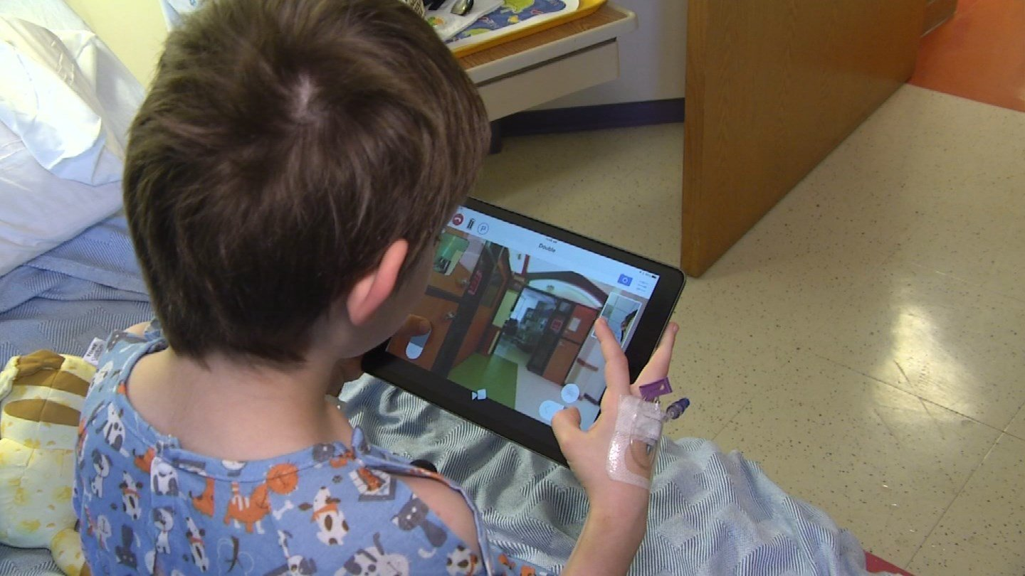 The idea behind the technology is to allow kids who can't leave their hospital room the chance to use an iPad and explore the whole building using a robot named Dubbs. (KCTV5)