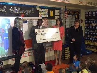 First-grade teacher Shannon C. Smith received a $1,000 check from the Missouri chapter of the National Education Association.  (KCTV5)