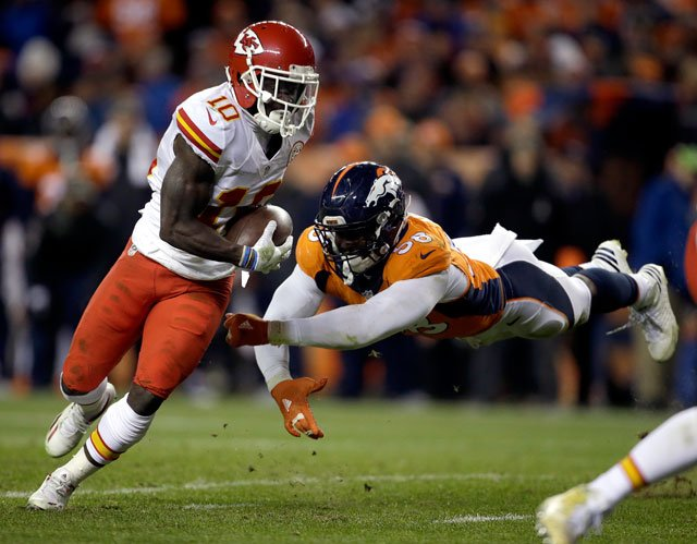 Kansas City Chiefs wide receiver Tyreek Hill (10) escapes the reach of Denver Broncos outside linebacker Von Miller (58) for a touchdown during the second half of an NFL football game, Sunday, Nov. 27, 2016, in Denver. (AP Photo/Joe Mahoney)
