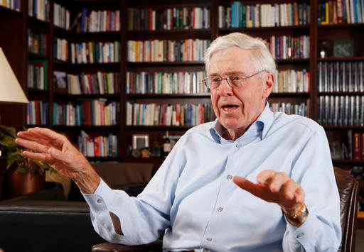 Charles Koch first likened candidate Donald Trump's plan to ban Muslim immigrants to something Adolf Hitler would have done in Nazi Germany. (AP)