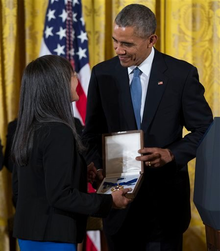 Laurie Yasui, accepts the Presidential Medal of Freedom from President Barack Obama on behalf of her father Minoru Yasui in 2015. (AP Photo/Evan Vucci)