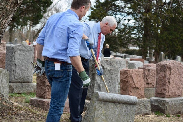 Vice President Mike Pence and Missouri Gov. Eric Greitens work together to clean a vandalized Jewish cemetery in University City, MO. (Facebook/Eric Greitens)