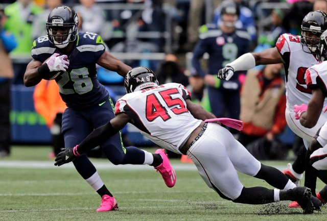 In this Oct. 16, 2016, file phot, Seattle Seahawks running back C.J. Spiller (28) is tackled by Atlanta Falcons strong middle linebacker Deion Jones (45) during the first half of an NFL football game. (AP)
