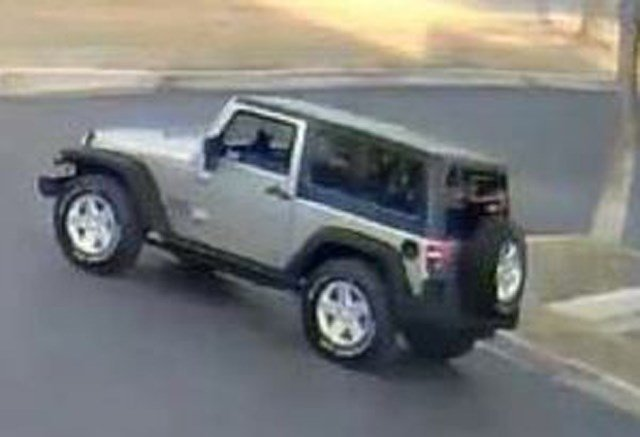 The man left the parking lot in a silver Jeep Wrangler, two door, with a black top and no visible license plate. (Leawood Police)